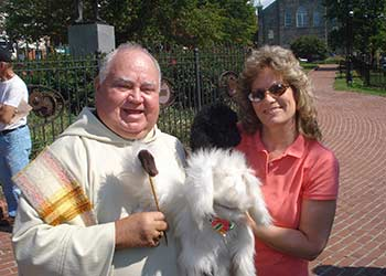"Myles & his stuffed TOY getting his blessing by Father Joe!!  Blessing of the Animals by Father Joe ""2012"""